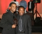 Larenz Tate poses with father Larry Tate after being awarded as a